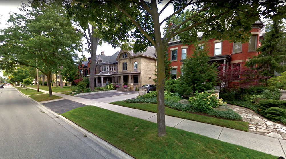 Large century homes with mature trees and beautiful landscaping in downtown London.