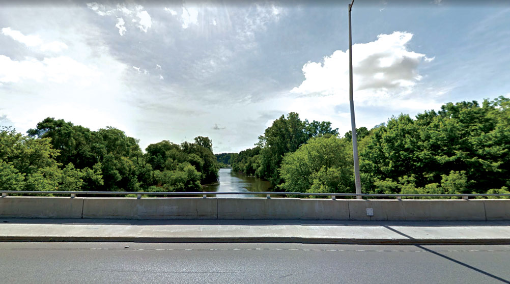 Bridge overlooking trees and river in south east London.